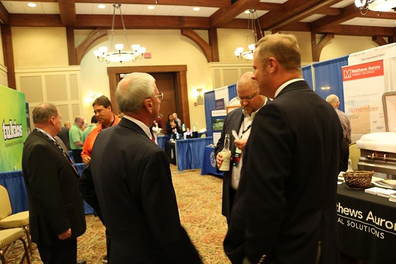 Men interacting in the exhibit hall at VFDA convention